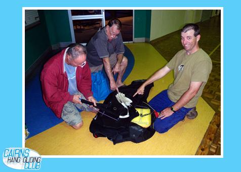 Brett checks Bob's parachute